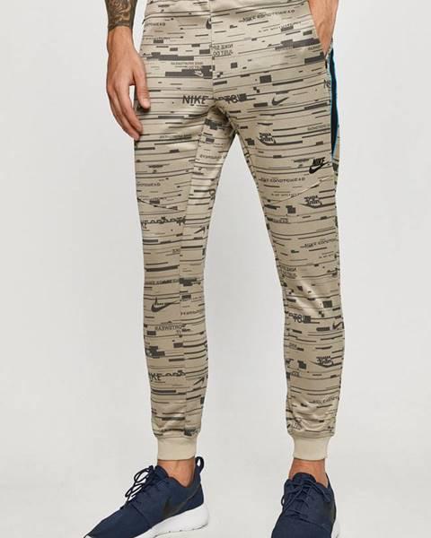 Zelené kalhoty Nike Sportswear