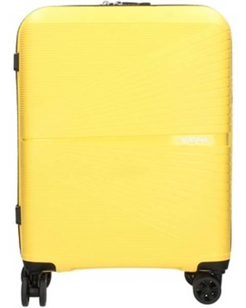 Žlutý kufr American tourister