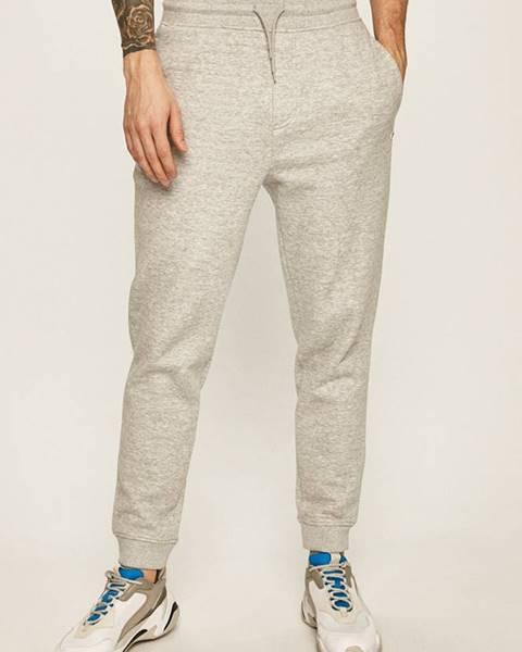 Šedé kalhoty Tommy Jeans