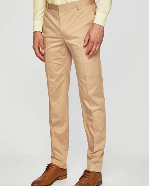 Béžové kalhoty Calvin Klein